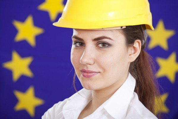 portrait of woman in safety helmet over european union flag